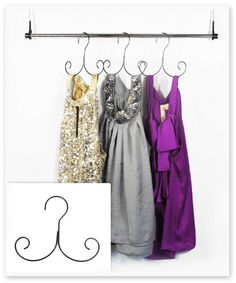 This unique hanger is specifically designed to hang slinky shirts and tank tops--no more of your favorite shirts falling off the hanger or getting excessively wrinkled in your drawer! The Curly Hanger Non Slip Hangers, Pant Hangers, Clothes Hangers, Black Hangers, Metal Hangers, Mardi Gras, Boot Storage, Storage Boxes, Closet Organization