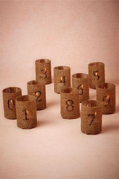Easy menorah idea! Burlap wrapped votives.