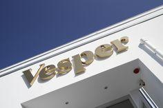 Vesper's logo above the main entrance.