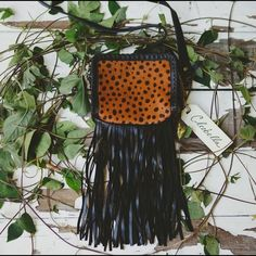 Cross body Cleobella leather and calf hair bag Printed calf hair brings exotic edge to this  Cleobella cross-body bag. Two wraparound zips open the stacked, lined interior compartments, and fringe hangs from the base. Slim shoulder strap.  We love it paired with flats and a simple blouse. Cleobella Bags