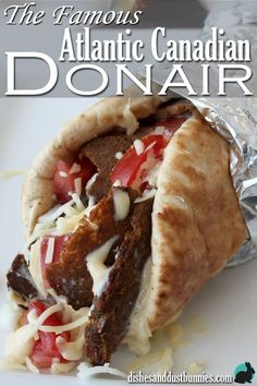 """How to make The Famous Atlantic Canadian """"Halifax Donair"""" Donairs or the """"Halifax Donair"""" are a famous and popular wrap from Atlantic Canada! Learn how to make your own homemade donair! They are so delicious and addictive! from dishesanddustbunn… Donair Meat Recipe, Donair Sauce, Halifax Donair Recipe, Poutine Recipe, Meat Recipes, Cooking Recipes, Sandwich Recipes, Recipies, Game Recipes"""