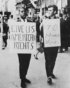 """Give us American rights""  ""Go home negro.""  This photo is from the Greensboro sit-ins, 1960. A black student pickets outside Woolworth's in Greensboro, North Carolina, in support of the lunch counter sit-in taking place inside. A white counter-demonstrator keeps in step with him.  [click on this image to find a bundle of clips related to the study of social movements and social change in sociology]"
