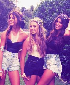 waist shorts, I like the girl on the far lefts outfit. Black shirt, high wasted shorts and the statement necklace really dresses it up!