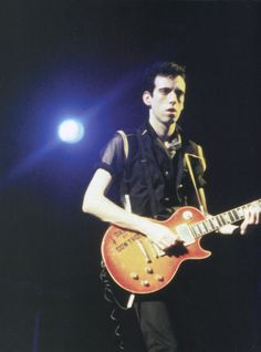 "superblackmarket: "" Mick Jones on stage at Bonds, 1981 """