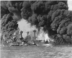 Battleships USS West Virginia and USS Tennessee in Flames (photo taken Dec. 7, 1941).