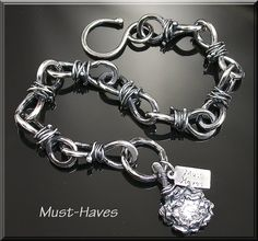 Twisted Handcrafted  Silver Bracelet. $79.99, via Etsy.