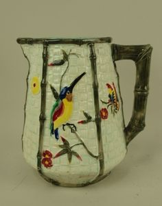 Fielding, attributed, Majolica Kingfisher and Prunus Pitcher
