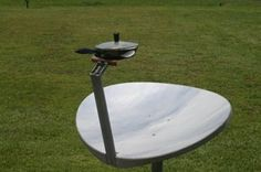 old dish at the city recycle area and converted it to a cooker by first sanding it smooth and covering with 2 strips of reflective vinyl covering Solar Oven Diy, Diy Solar, Emergency Preparation, Survival Prepping, Luz Natural, Solar Energy Panels, Solar Panels, Tent Living, Solar Cooker