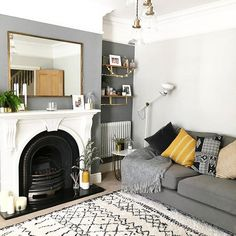 and work together to create a harmonious grey colour scheme in this contemporary living room. The subtle mustard accents… – Living Room Mustard Living Rooms, Grey And Yellow Living Room, Cosy Living Room Grey, Grey Living Room Paint, Living Room Decor Colors Grey, Mustard And Grey Bedroom, Grey Colour Scheme Bedroom, Grey Wall Decor, New Living Room
