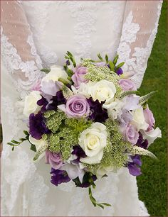 "We so often think ""white"" for wedding flowers. Isn't this bouquet interesting? It has white and purple roses. Is that Lisianthus in there? But this bouquet is a real eye catcher! If you like purple, this is a good idea. Purple Wedding Bouquets, Wedding Flower Arrangements, Bride Bouquets, Bridal Flowers, Floral Arrangements, Purple Flowers, Flower Bouquets, Bouquet Wedding, Flowers Pics"