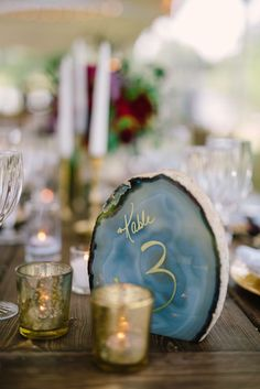 Blue Agate Gold Calligraphy Table Number | Belle of the Ball Events | Diastole Farms | Harwell Photography https://www.theknot.com/marketplace/harwell-photography-atlanta-ga-211226