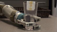 One challenge for robots is mastering human dexterity, like gripping and picking up cups