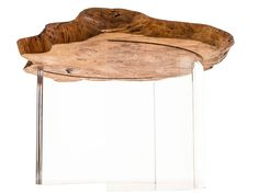 1970 table series: aged burl set on curved clear acrylic legs.