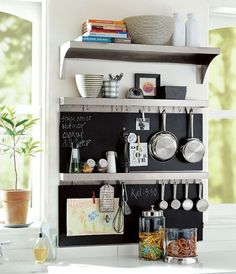 inside cabinet, chalk board paint & cup hooks & measuring tools~