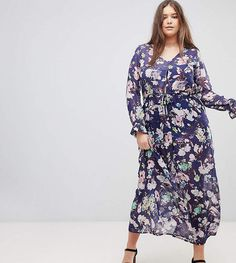 e00bc562e2a 17 Maxi Dresses You ll Want to Add to Your Wardrobe Immediately Navy Floral  Dress