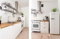 smeg fridge and white kitchen ... nice countertops and floors