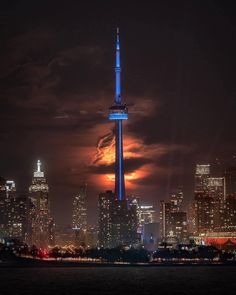 """""""The CN tower in front of an ominous Super Blood Moon. One of my favorite images taken in Toronto."""" Be Visually… Toronto Ontario Canada, Toronto City, Canada Day Fireworks, Happy Canada Day, Blood Moon, Famous Landmarks, My Favorite Image, City Lights, Cn Tower"""