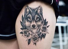 Elegant wolf tattoo on thigh by Kristi Walls