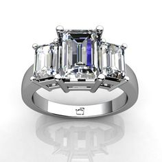 Three Stone Emerald Cut Diamond Ring.    This Past, Present and Future Ring for Emerald Cut Diamonds uses basket style settings to showcase the diamond's brilliance..  *Purchase this for as little as $50.00 per month