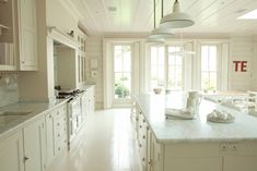 plain english white kitchen with solid shutters at the windows