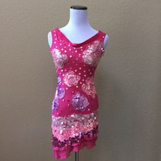 """Marciano silk sequined dress Marciano pink silk asymmetrical dress with sequin detail. Back has scattered sequin detail and no flowers like on front. One sequin missing as shown in third photo, not noticeable when worn. Outer layer is silk, inner layer synthetic. Measures about 33"""" on longest side and 29"""" on short side. Please be aware this dress is VERY short, some people may prefer to wear it as a tunic. Marciano Dresses Mini"""