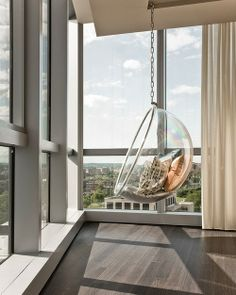 Get the look : Suspended Ring Chair - clear acrylic bubble window seating creates cozy mod statement! *stand also available if unable to hang from ceiling*