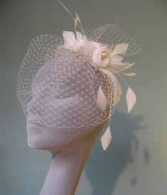 jane taylor millinery.  Floral pin with veil.