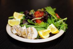 My lunch today... simple mixed greens with chicken, fresh lemon juice for dressing.