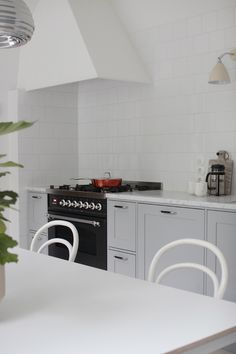 Kitchen from Unique Home (Turku), color of cabinets Tikkurila Pro Grey 1938. Countertop Carrera marble