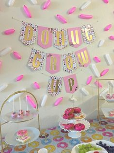 For our daughter's 4th birthday, we decided to go with a donut theme. My daughter loves donuts and I love how cute they look! I bought most of the party supplies on Amazon. I made the banner and the cake pops myself. The cookies were baked & decorated byBest Cookies By Farr and the invitation was designed by JanePaperie on Etsy. For additional information, please see my blog: www.unsaltedmama.com