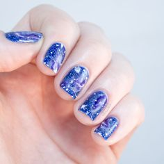 Zoya Mosheen (1 coat over black creme) is a special effect top coat with holographic bar glitter and circular (or maybe hexagonal...my eyes aren'...  #freehand #galaxy #glamorous #nail art #Space #swirls #nails #nailpolish