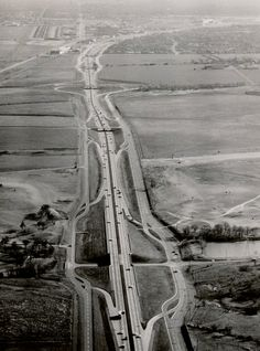 This is a shot of Central Expressway in 1959, looking south toward downtown.  The overpass at the bottom of the photo is Walnut Hill Lane. Park Lane is the next overpass and then the cloverleaf overpass is Northwest Highway.