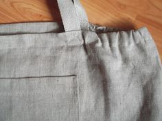 Organic Linen Beach Bag Market Linen Bag Tote Gray Washed Linen  A linen tote bag in a gray is roomy enough for beach blanket, towel or a weekend picnic and lightweight enough for every day use.   Nice eco friendly gift!   It has 1 pocket on the front.  .  Linen fabric for this bag is washed and will not shrink.  This listing is for 1 bag in size:20x 14x 2.5(49 cm x 35 cm x6 cm).  Two handles of gray linen cord are 16.5(42 cm) long .   Please feel free to contact me if you have any questions…