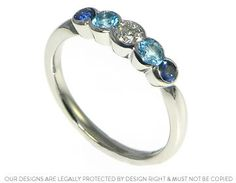 David and Gill's sapphire, topaz and diamond eternity ring
