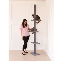 Cats love to climb and scratch, which can be very bad news for your furniture and curtains. This tree lets them use their natural agility to clamber u. Large Cat Tree, Cat Tree House, Kinds Of Cats, Scratching Post, Cat Furniture, Innovation, Ceiling, Pets, Bad News