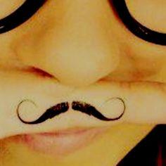 Mustache finger tattoo