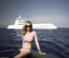 MrsMelnichenko, pictured in front of the massive yacht, said there is a back-lit Baccarat crystal dining table on board