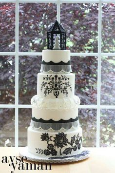 Black and white cake with elegant and unique topper.