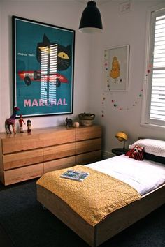 Kids room. Oversized poster, walnut dresser, muted colour scheme industrial lighting