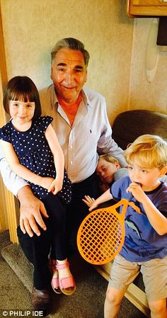 Downton Abbey ~ Jim Carter, who plays butler Carson, looks after Fifi, Zac and Oliver during a break