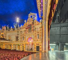 the chicago theatre a full auditorium with the audience lighted wide angle showing the balcony. Black Bedroom Furniture Sets. Home Design Ideas