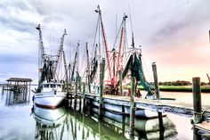 Shem Creek in Mount Pleasant, South Carolina.  Shem Creek is home to some of my favorite restaurants, kayaks, boats large and small, pelicans, seagulls, and playful several dolphins.  Photo by mmulligan1095 (flickr: 9162005@N07)