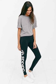 Sporty-chic leggings from adidas Originals. Softy + stretchy cotton cut with a slim-fit leg and mid-rise finished with the iconic adidas logo down the leg.