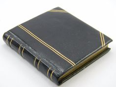 VINTAGE VOLUPTE COMPACT PRISTINE INTERIOR BLACK LEATHER /GOLD TRIM BOUND BOOK