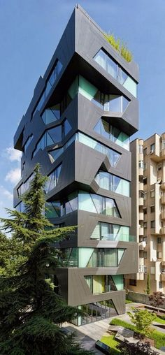 Designed by Aytac Architects in the Apartman 18 building design is a far cry from the concrete cookie-cutter buildings surrounding it. Futuristic Architecture, Facade Architecture, Beautiful Architecture, Contemporary Architecture, Commercial Architecture, Building Facade, Building Exterior, Building Design, Building Images