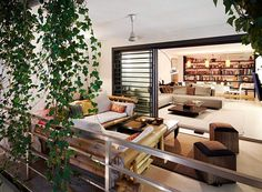 We love this little #porch meets #terrace area which completes the living space of this home perfectly. The #openplan style stretches seamlessly from the from the #diningroom to the #livingroom and straight out onto the balcony, creating a feeling of unison. The really cool thing is that in terms of style, this home seems #modern but small touches of #bamboo and greenery give it a fresh, creative and open feeling. Design by Fanstudio Architecture & Design. Get plans, ideas and inspiration…
