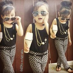 While this is cute to look at I find this to be too grown for a little girl to actually wear. She looks like she's playing dress up.