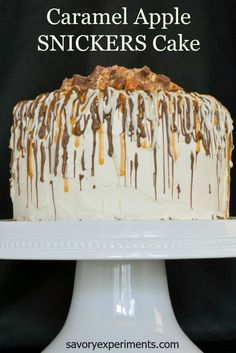 Caramel Apple SNICKERS® Cake - 3 layers of yellow cake with baked green apples, white frosting, chopped SNICKERS® , caramel drizzle and dressed with white and milk chocolate  #WhenImHungry
