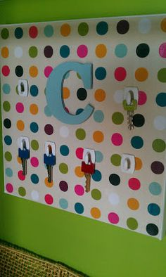 Custom key rack made from a 12x12 canvas and scrapbook paper!
