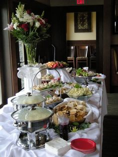 Example of using lifts on your buffet table. you can use anything from a can of paint, over turned bowl, basket, ect. Just make sure it is steady enough. The tablecloths thrown over and puddled around them disguise and give added interest. Be sure to use caution when puddling around your chafing dishes. Unless you want the fire department at your party....
